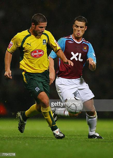 Scott Parker of West Ham United tries to tackle David Norris of Plymouth Argyle during the third round of the Carling Cup match between West Ham...