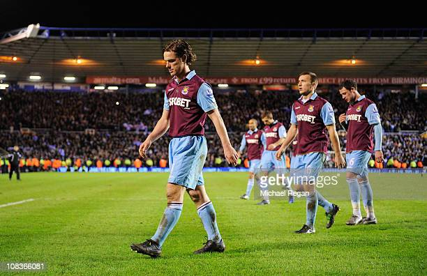 Scott Parker of West Ham United walks off dejected with team mates after the Carling Cup Semi Final Second Leg match between Birmingham City and West...