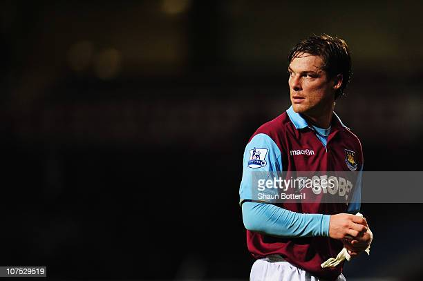 Scott Parker of West Ham United walks off the pitch following the Barclays Premier League match between West Ham United and Manchester City at Upton...