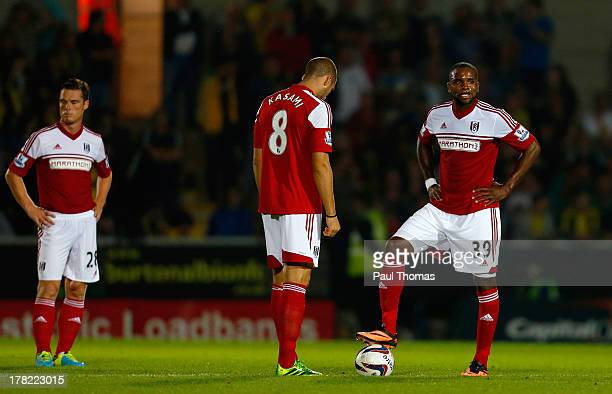 Scott Parker Pajtim Kasami and Darren Bent of Fulham react after Burton Albion score their first goal during the Capital One Cup Second Round match...