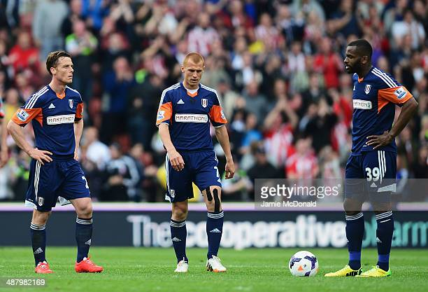 Scott Parker Steve Sidwell and Darren Bent of Fulham react as their side concedes a second goal during the Barclays Premier League match between...