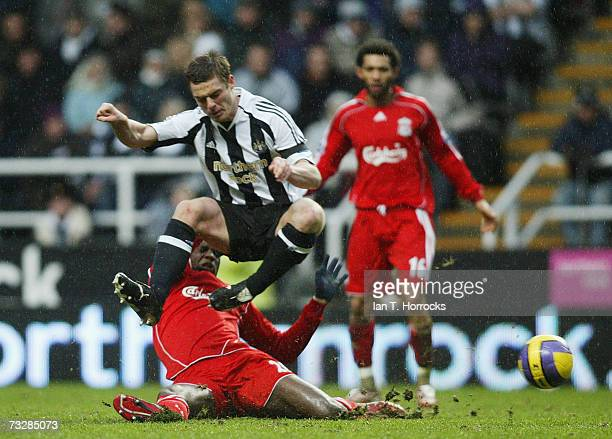 Scott parker straddles the challenge of Momo sissoko during the Barclays Premiership match between Newcastle United and Liverpool at St James Park on...