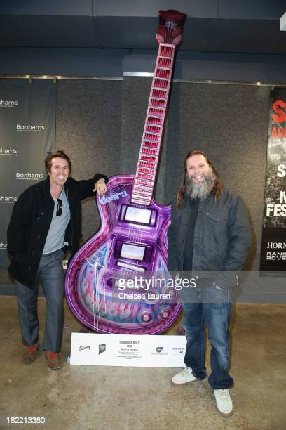 Scott Patterson and artist Risk attend the private media preview reception for 2012 Gibson Guitartown on the Sunset Strip's charity auction at...