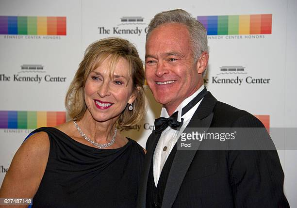 Scott Pelley and his wife, Jane Boone, arrive for the formal Artist's Dinner honoring the recipients of the 39th Annual Kennedy Center Honors hosted...
