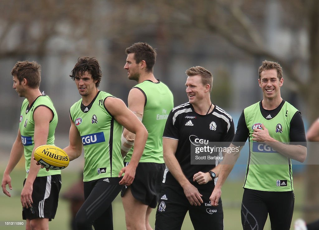 Scott Pendlebury and Nick Maxwell of the Magpies laugh with Nathan Buckley, coach of the Magpies during a Collingwood Magpies AFL training session at Gosch's Paddock on September 6, 2012 in Melbourne, Australia.