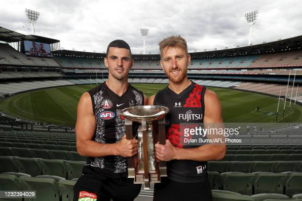 Scott Pendlebury of the Magpies and Dyson Heppell of the Bombers pose for a photo during the ANZAC Day Media Opportunity at the Melbourne Cricket...