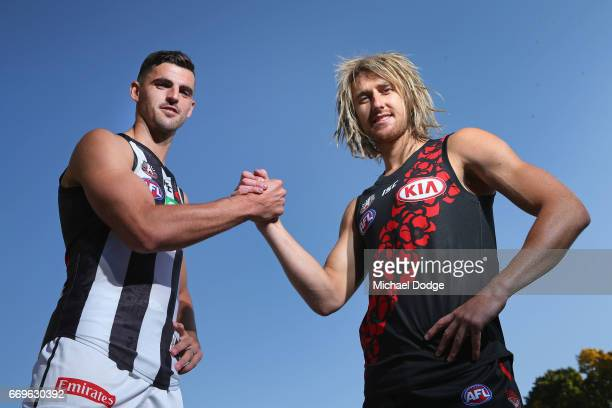 Scott Pendlebury of the Magpies and Dyson Heppell of the Bombers pose during an AFL media opportunity for their clash on Anzac Day at Melbourne...