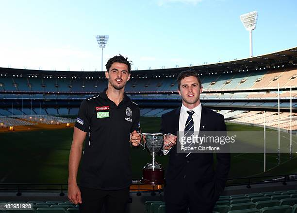 Scott Pendlebury of the Magpies and Marc Murpy of the Blues pose with the Peter Mac Cup during the the Peter Mac Cup Breakfast at Melbourne Cricket...