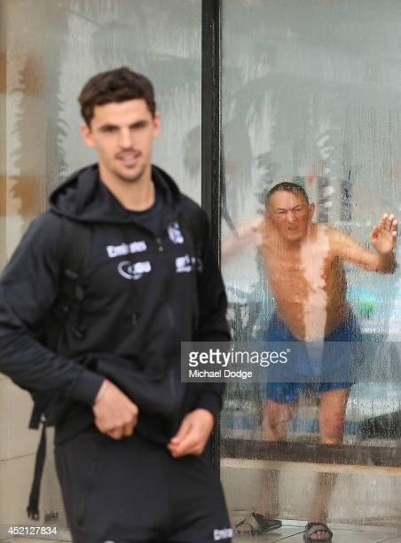 Scott Pendlebury of the Magpies arrives as an onlooker peers through the StKilda Baths window during a Collingwood Magpies AFL recovery session at St...