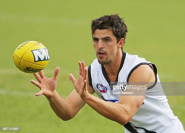 Scott Pendlebury of the Magpies catches the ball during a Collingwood Magpies AFL training session at Gosch's Paddock on April 28 2014 in Melbourne...