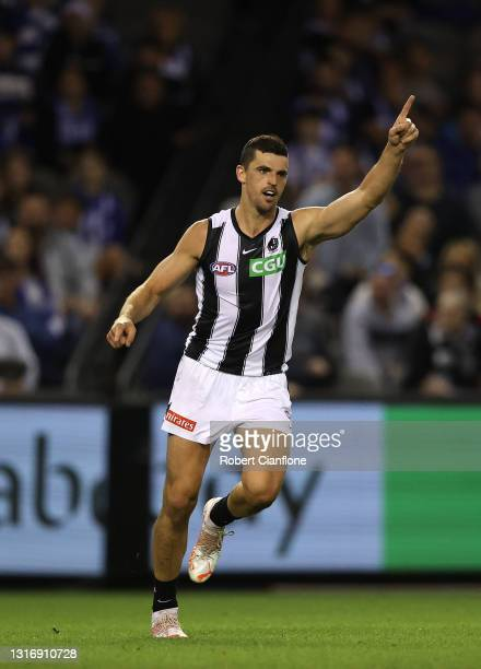 Scott Pendlebury of the Magpies celebrates after scoring a goal during the round eight AFL match between the North Melbourne Kangaroos and the...