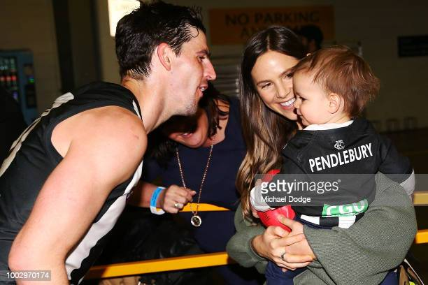 Scott Pendlebury of the Magpies celebrates the win wife his wife and child during the round 18 AFL match between the Collingwood Magpies and the...