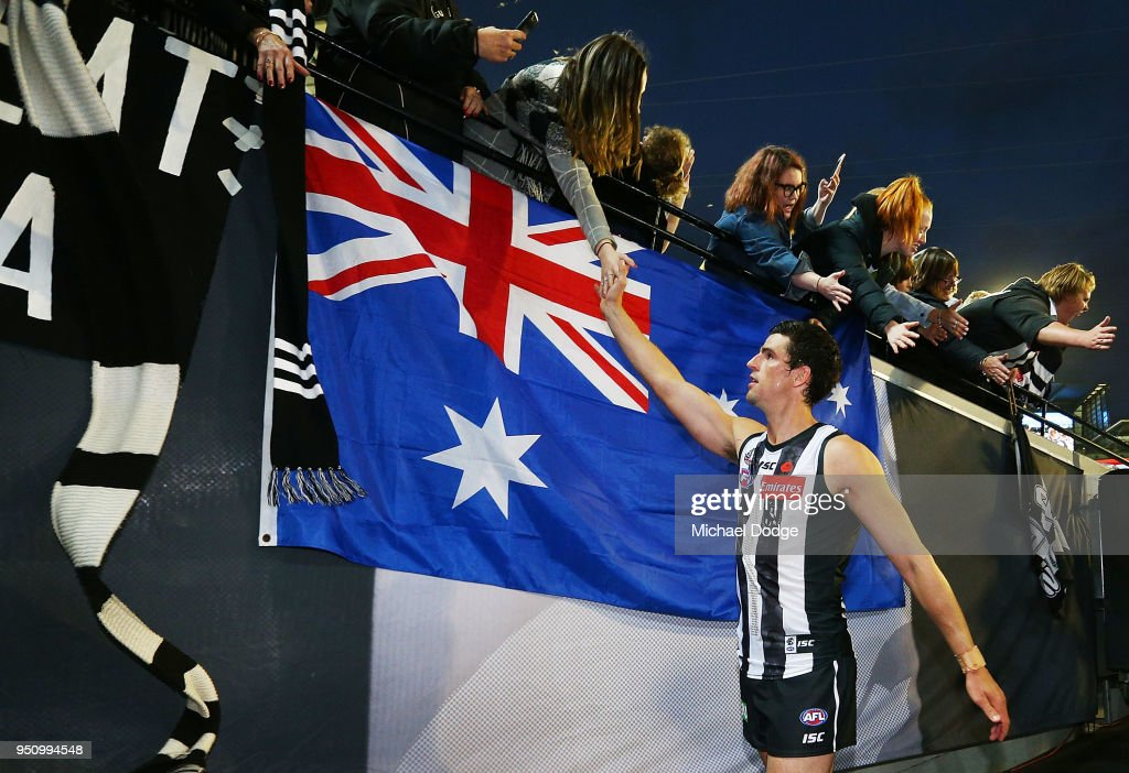 Scott Pendlebury of the Magpies celebrates the win with fans during the round five AFL match between the Collingwood Magpies and the Essendon Bombvers at Melbourne Cricket Ground on April 25, 2018 in Melbourne, Australia.