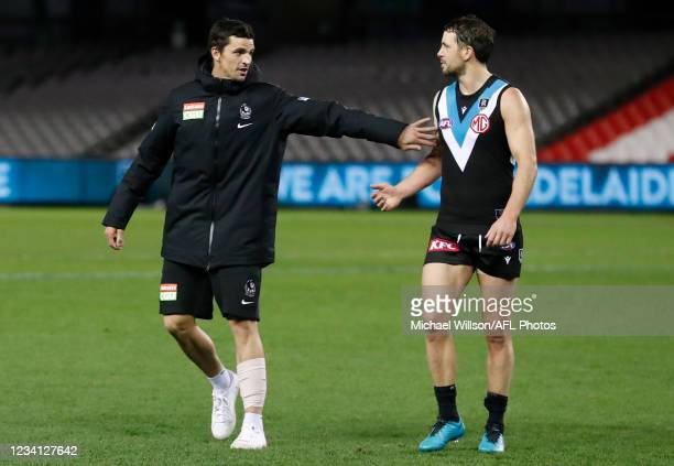 Scott Pendlebury of the Magpies congratulates Travis Boak of the Power after his 300th match during the 2021 AFL Round 19 match between the Port...