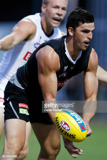 Scott Pendlebury of the Magpies handpasses the ball during the Collingwood Magpies AFL Intra Club match at the Holden Centre on February 22 2018 in...