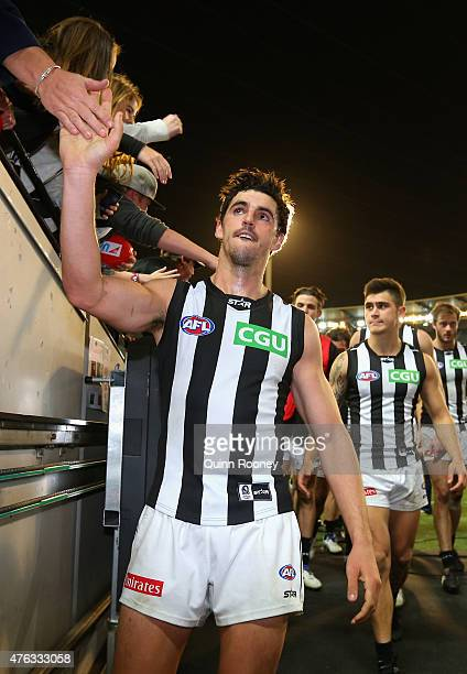 Scott Pendlebury of the Magpies high fives fans after winning the round 10 AFL match between the Melbourne Demons and the Collingwood Magpies at...