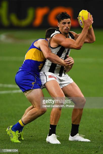Scott Pendlebury of the Magpies holds up in a tackle during the 2020 AFL First Elimination Final match between the West Coast Eagles and the...