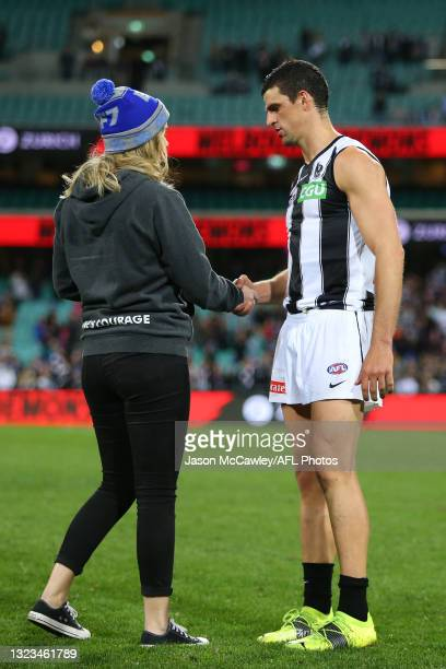 Scott Pendlebury of the Magpies is presented the Neale Daniher Trophy during the round 13 AFL match between the Melbourne Demons and the Collingwood...