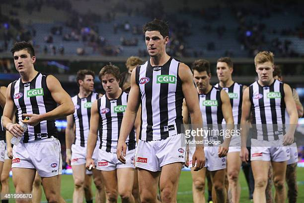 Scott Pendlebury of the Magpies leads teamates off after defeat during the round 17 AFL match between the Western Bulldogs and the Collingwood...