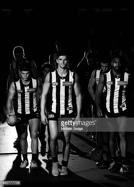 Scott Pendlebury of the Magpies leads the team out during the round 18 AFL match between the Collingwood Magpies and the Adelaide Crows at Melbourne...