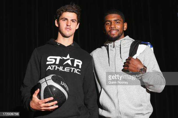 Scott Pendlebury of the Magpies poses with Kyrie Irving of the Cleveland Cavaliers NBA team during a Collingwood Magpies appearance at Westpac Centre...