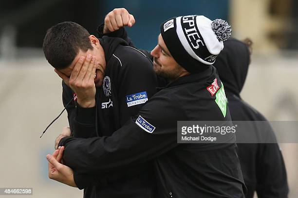 Scott Pendlebury of the Magpies reacts while taking part in a mock UFC battle with Steele Sidebottom during a Collingwood Magpies AFL training...