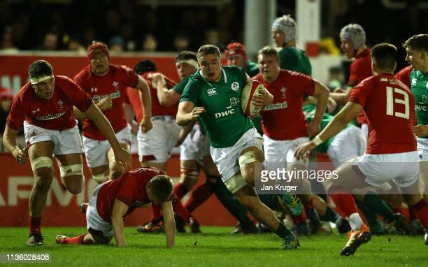 Scott Penny of Ireland U20 breaks through the Wales defence during the U20 Six Nations match between Wales and Ireland at Zip Word Stadium on March...