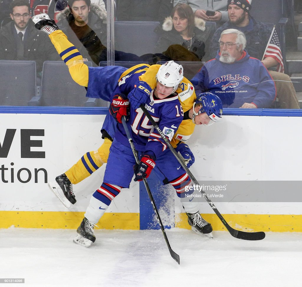 Scott Perunovich #15 of United States checks Elias Pettersson #14 of Sweden during the third period of play in the IIHF World Junior Championships Semifinal game at KeyBank Center on January 4, 2018 in Buffalo, New York.