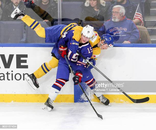 Scott Perunovich of United States checks Elias Pettersson of Sweden during the third period of play in the IIHF World Junior Championships Semifinal...