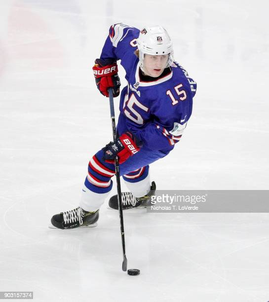 Scott Perunovich of United States skates the puck against Sweden during the first period of play in the IIHF World Junior Championships Semifinal...