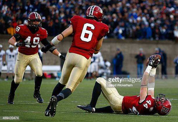 Scott Peters of the Harvard Crimson celebrates following his interception with 10 seconds remaining in the fourth quarter against the Yale Bulldogs...