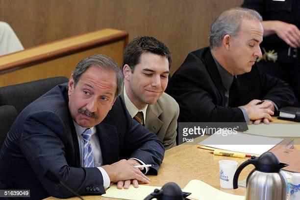 Scott Peterson and his defense attornies Mark Geragos and Pat Harris listens as prosecutor Rick Distaso makes closing arguments at the San Mateo...