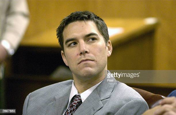 Scott Peterson listens to prosecutor Joseph Distaso respond to defense attorney Mark Geragos' petition for dismissing double murder charges against...