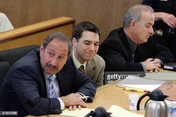 Scott Peterson listens with his defense attornies Mark Geragos and Pat Harris as prosecutor Rick Distaso makes closing arguments at the San Mateo...