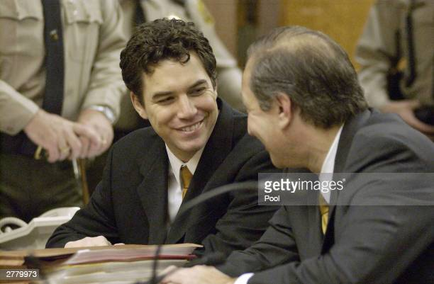 Scott Peterson sits with attorney Mark Geragos during arraignment proceedings at the Stanislaus Superior Court December 3 2003 in Modesto California...