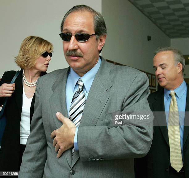 Scott Peterson's attorney Mark Geragos and his defence team leave the San Mateo County courthouse in Redwood City, California on Wednesday June 9,...