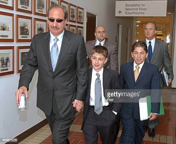Scott Peterson's attorney Mark Geragos leaves for a lunch break during the Peterson double murder trial with his son, Jake Geragos and his nephew...