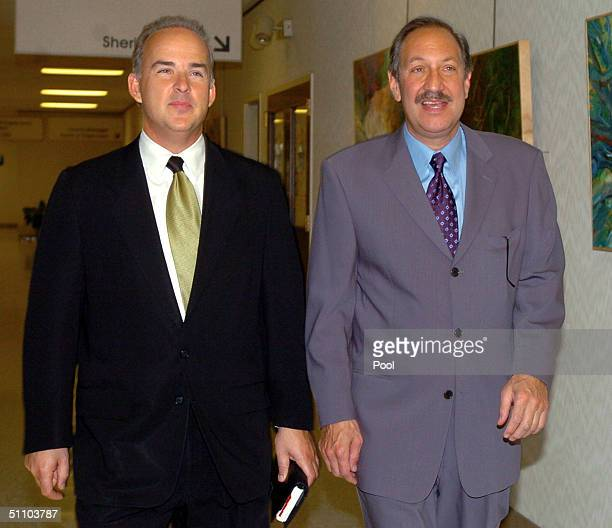 Scott Peterson's defense attorneys Mark Geragos and Pat Harris return to the San Mateo County Courthouse July 21, 2004 in Redwood City, California....