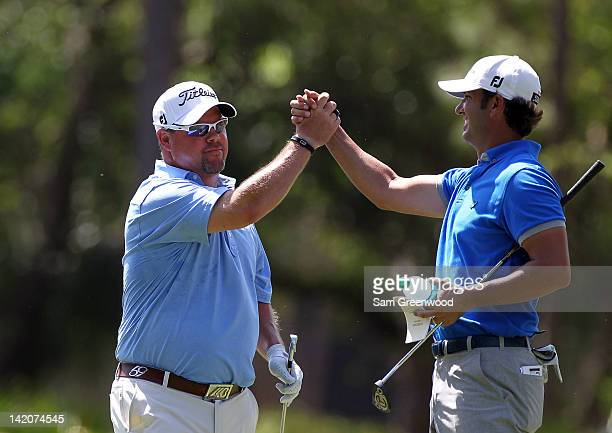 Scott Piercy congratulates Kris Blanks following a holeinone during the final round of the Transitions Championship at the Innisbrook Resort and Golf...