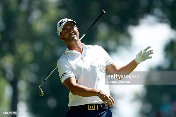Scott Piercy drops his club after a shot on the 18th hole during the first round of the World Golf Championships Bridgestone Invitational at...