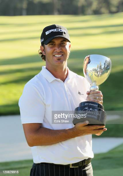 Scott Piercy holds the trophy after he won the RenoTahoe Open at Montreux Golf Country Club on August 7 2011 in Reno Nevada