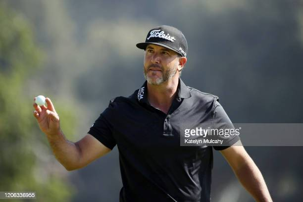 Scott Piercy of the United States acknowledges the crowd on the second hole during the second round of the Genesis Invitational on February 14 2020...