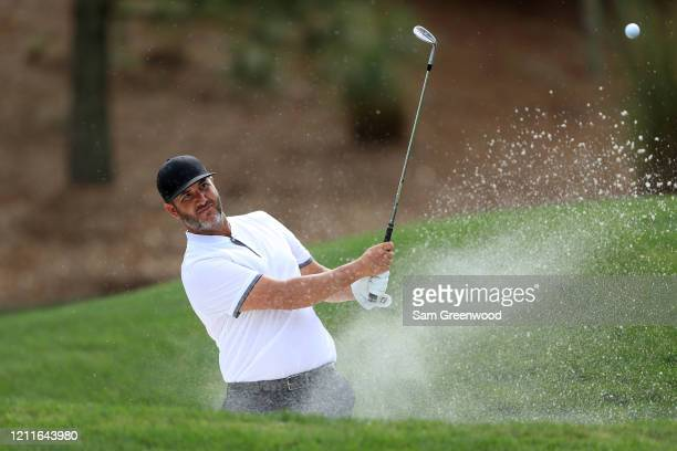 Scott Piercy of the United States plays a shot from a bunker during a practice round prior to The PLAYERS Championship on The Stadium Course at TPC...