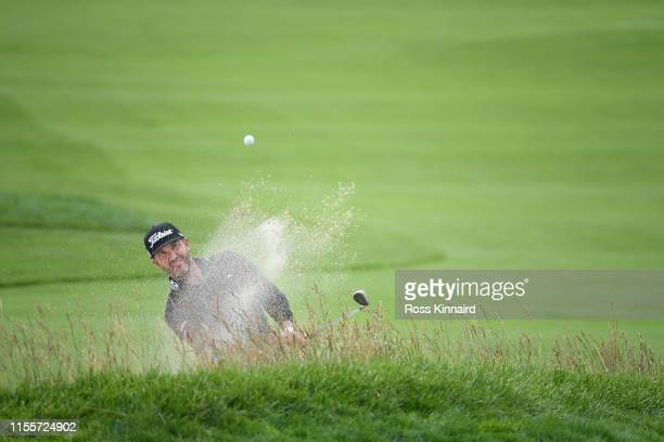 Scott Piercy of the United States plays a shot from a bunker on the 15th hole during the first round of the 2019 US Open at Pebble Beach Golf Links...