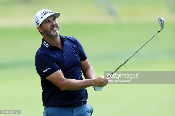 Scott Piercy of the United States plays a shot on the 16th hole during the first round of the BMW Championship at Medinah Country Club No 3 on August...
