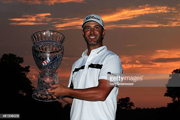 Scott Piercy of the United States poses with the trophy after winning the Barbasol Championship at the Robert Trent Jones Golf Trail at Grand...