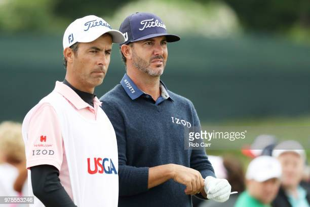 Scott Piercy of the United States prepapes to make his shot on the eighth tee as caddie Travis Perkins looks on during the second round of the 2018...