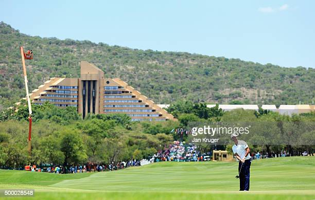Scott Piercy of the United States putts on the 1st hole during day three of the Nedbank Golf Challenge at Gary Player CC on December 5 2015 in Sun...