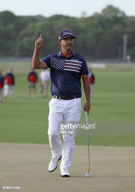 Scott Piercy of the United States reacts to a putt on the 16th green during the third round of the 2018 US Open at Shinnecock Hills Golf Club on June...