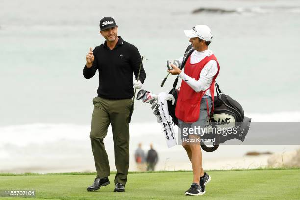Scott Piercy of the United States reacts to a shot on the tenth hole during the first round of the 2019 US Open at Pebble Beach Golf Links on June 13...